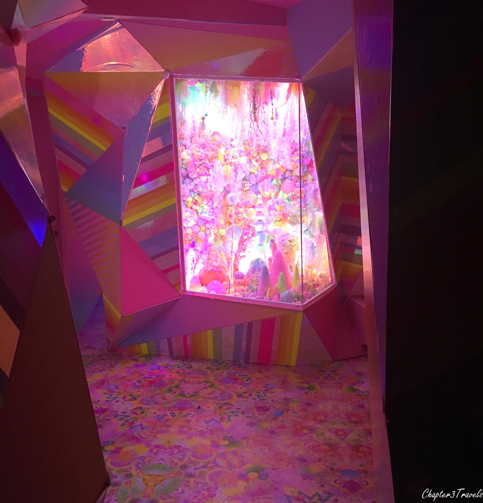 Colorful pink room with angled walls at Meow Wolf
