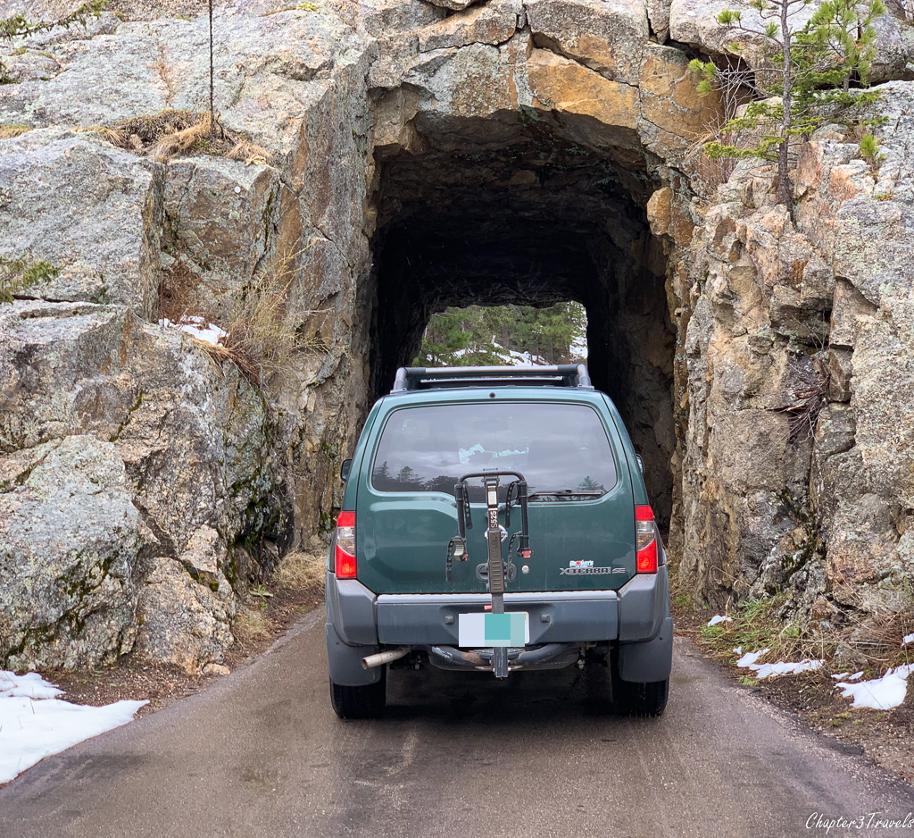 Xterra driving into small stone tunnel
