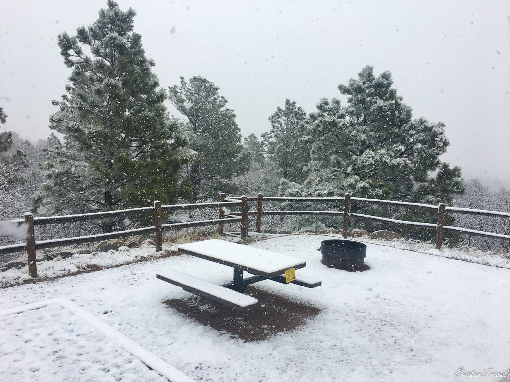 Campsite covered in snow at Cheyenne Mountain State Park