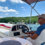Dave steering the pontoon boat