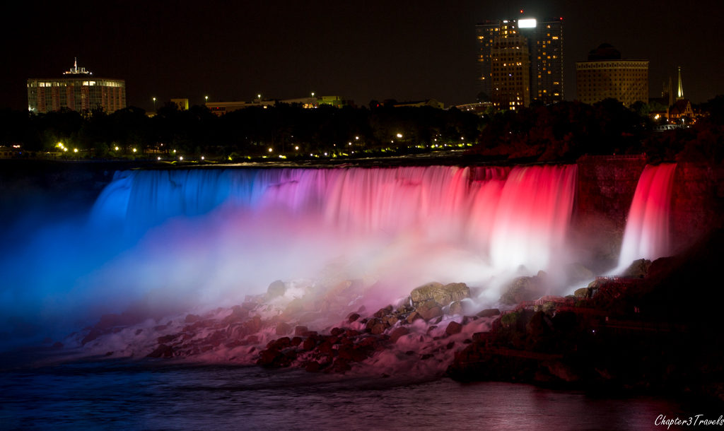 Niagara Falls lit up at night in red, white, and blue