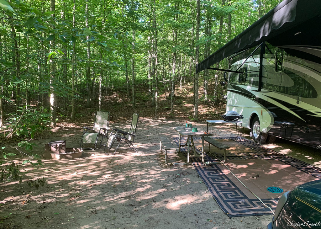 Forested RV campsite at Munising KOA