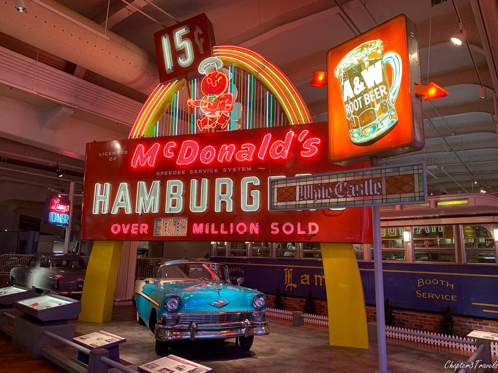 15 cent hamburger sign at McDonald's and 1950's vehicle