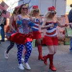 Women in costumes walking through the French Quarter