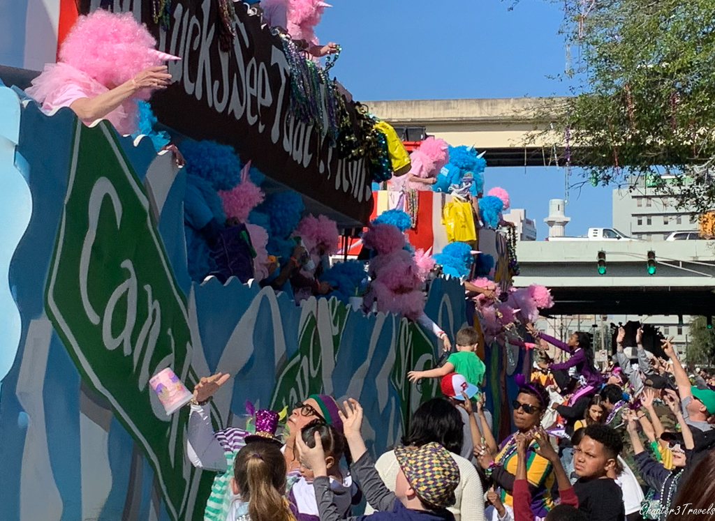 Parade goers interacting with krewes at Mardi Gras