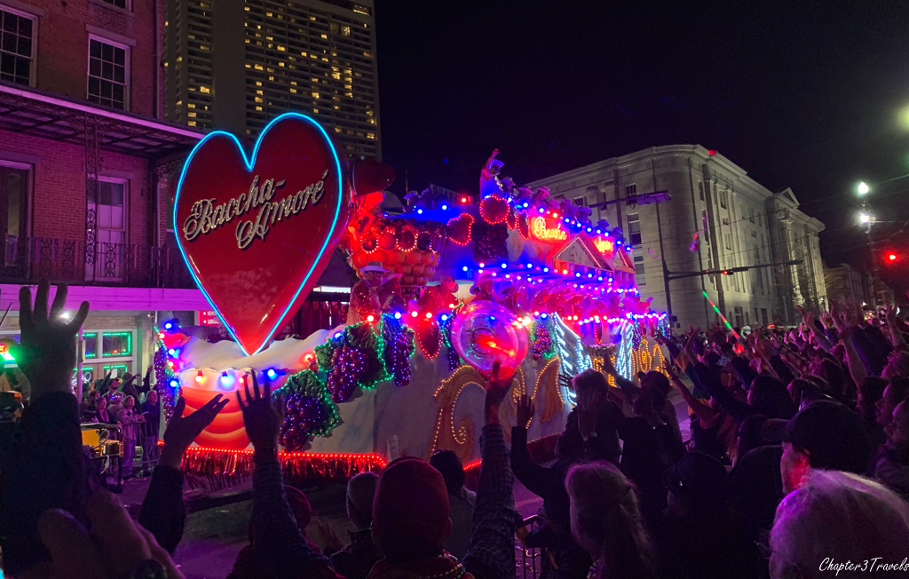 Parade floats illuminated at night during Mardi Gras