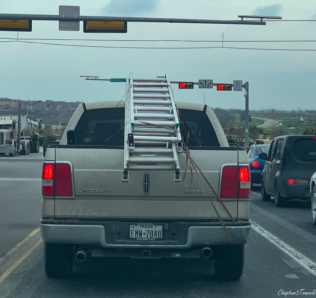 Pick up truck with ladder attached to back
