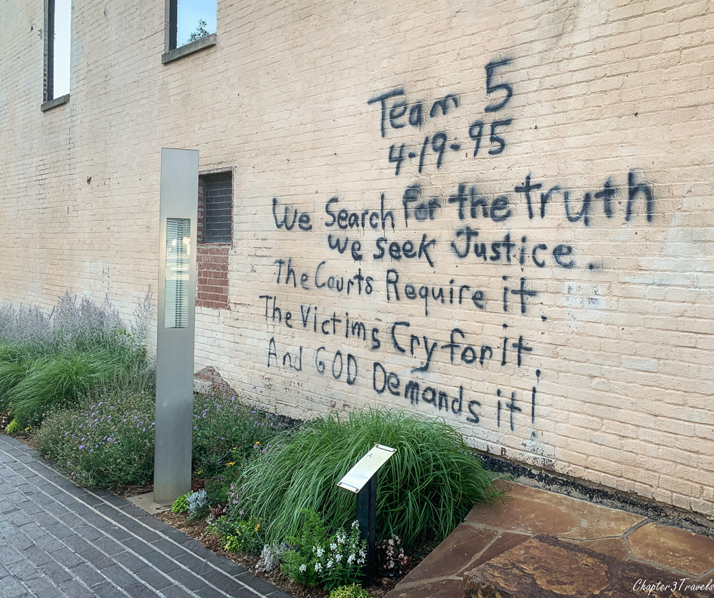 Spray painted message from rescue worker on wall