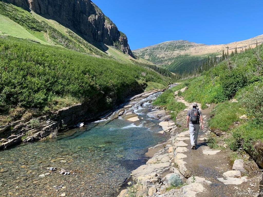 Walking next to creek on Piegan Pass Trail