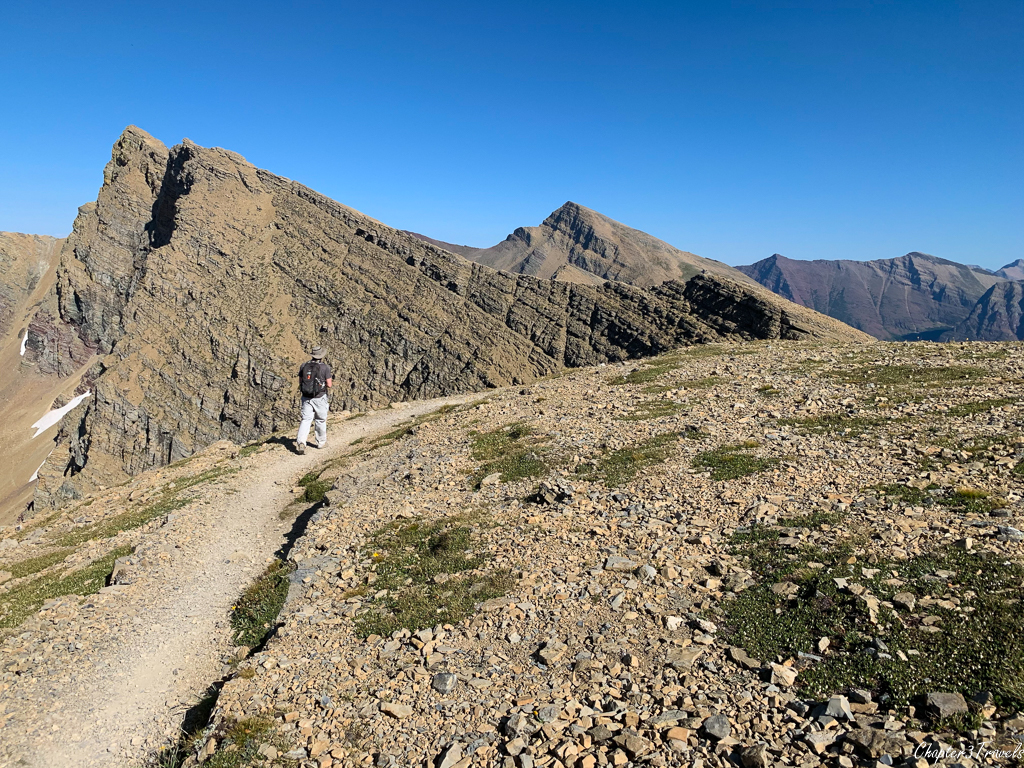 Walking along ridge of the Siyeh Pass trail in Glacier National Park