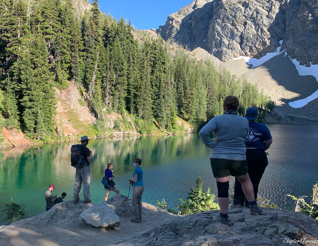Several hikers looking at the Blue Lake in North Cascades
