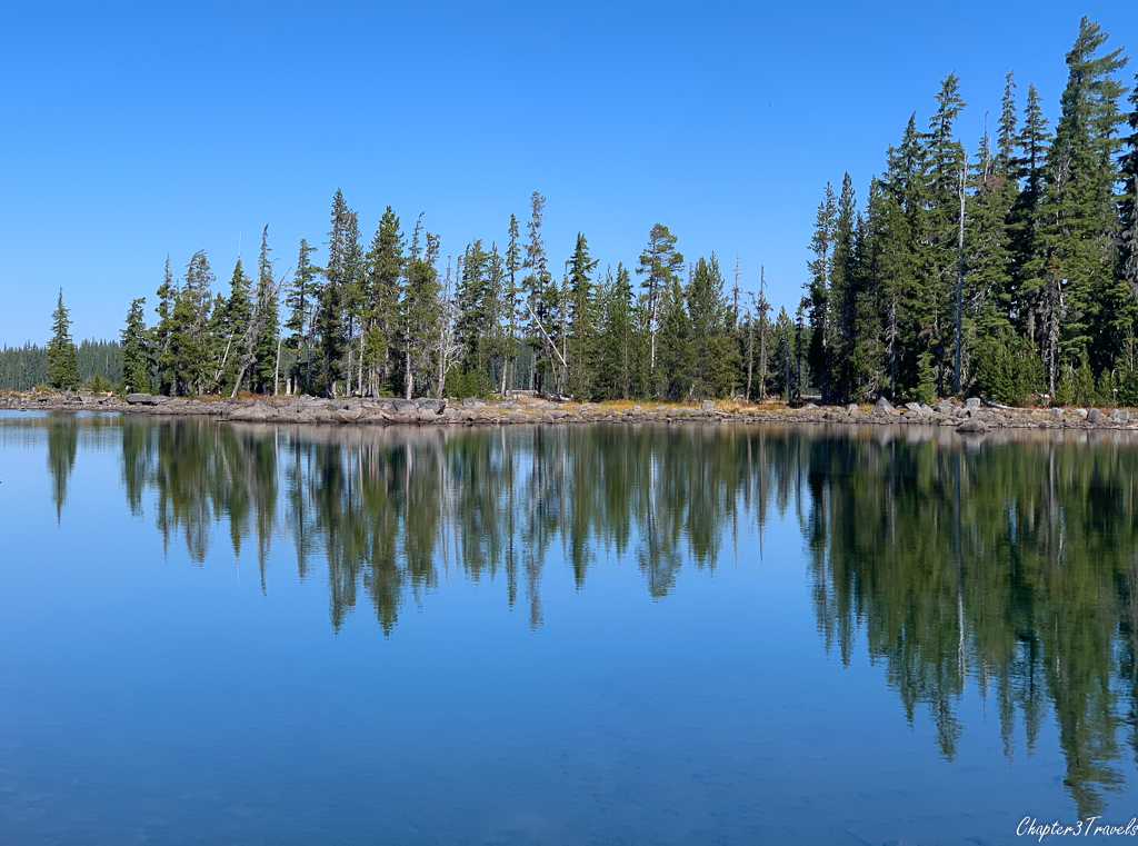 Trees reflected in the water at Waldo Lake