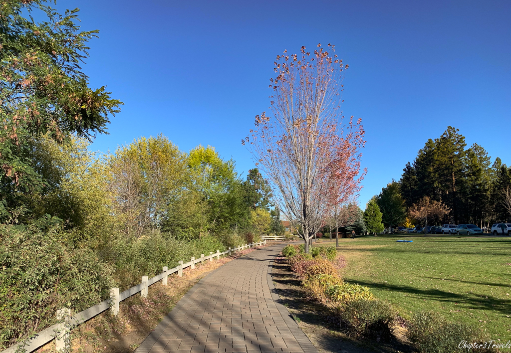 A paved trail in a park in Bend