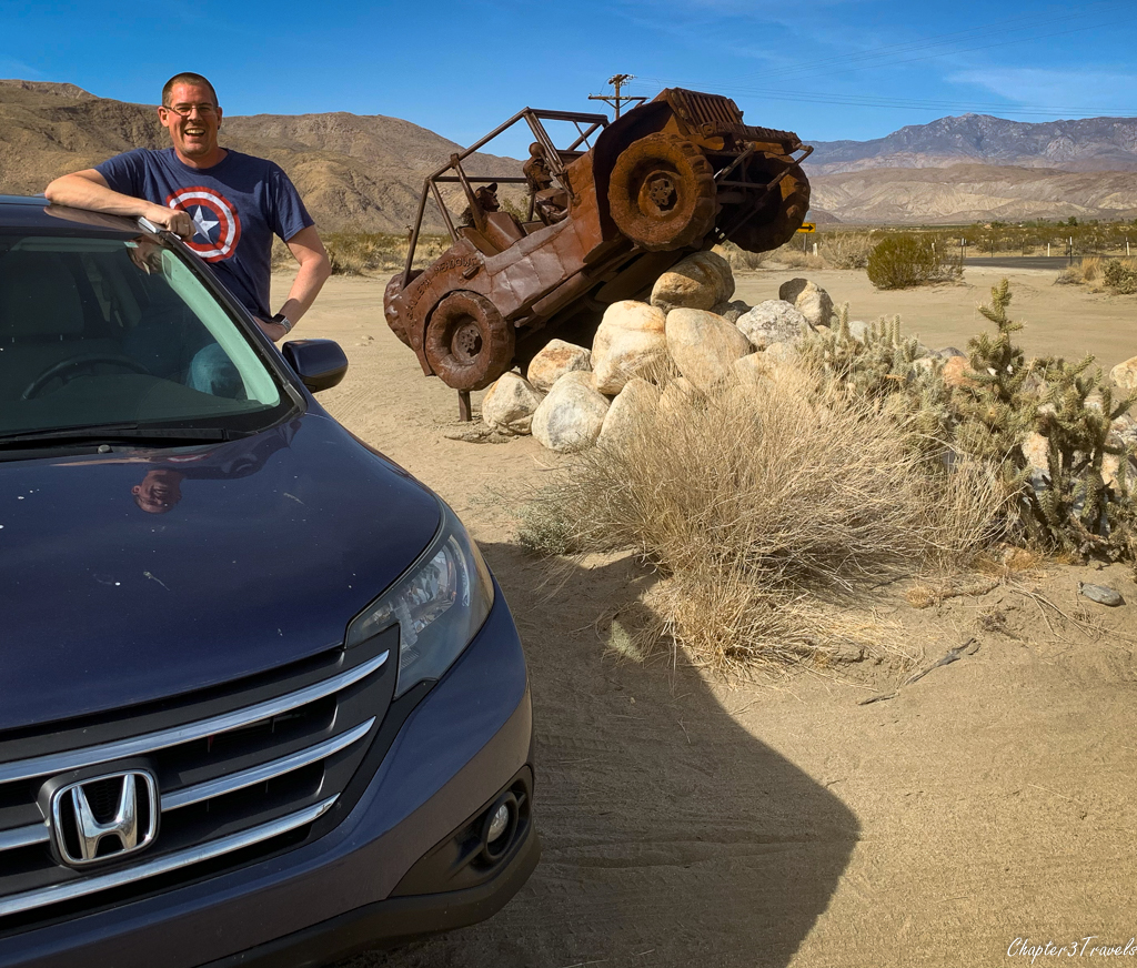 Kevin in CR-V in front of Jeep sculpture in Borrego Springs