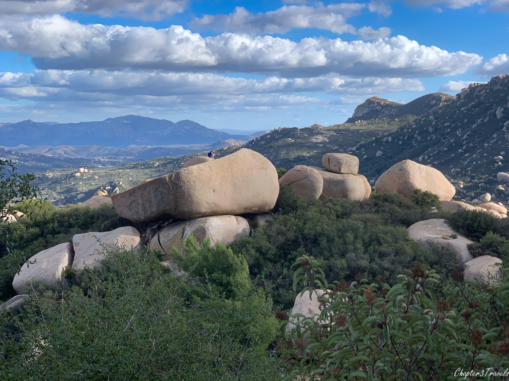 View of boulders and mountains in the distance on the Mt. Woodson Trail