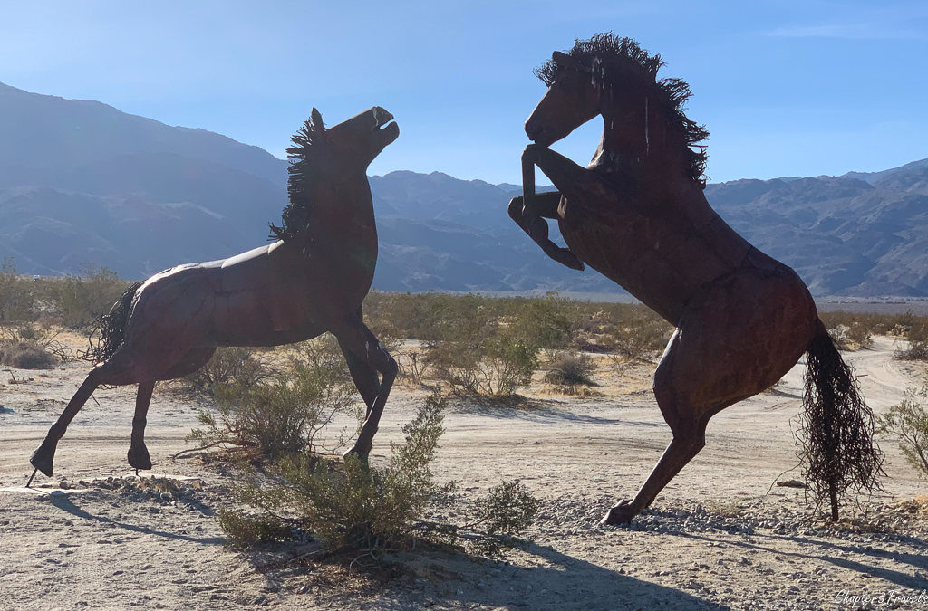 Horses sculpture with too much light and lens flare in Borrego Springs