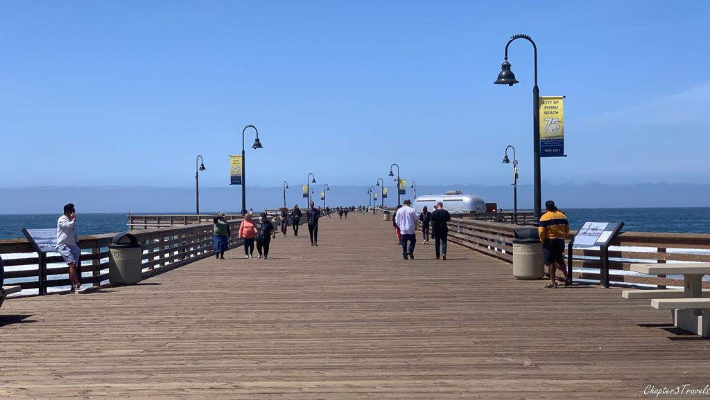 People walking on large fishing pier