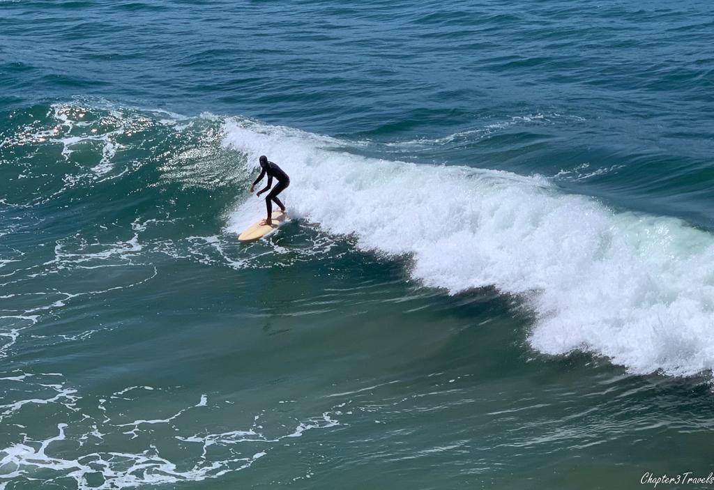 Man surfing at Pismo Beach