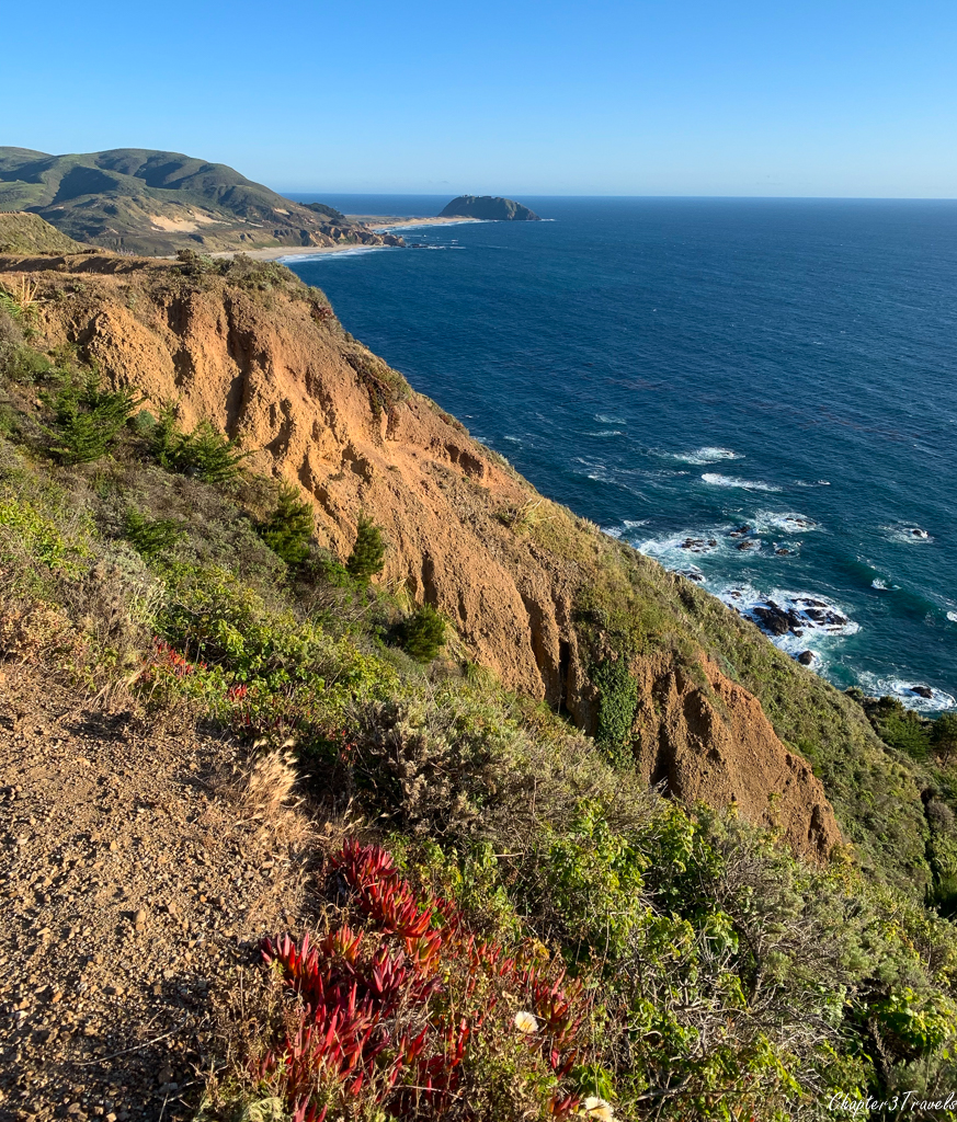 View of cliffs and ocean at sunset on Pacific Coast Highway