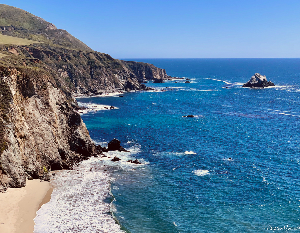 Rocky coastline, tall cliffs, and blue water at Big Sur