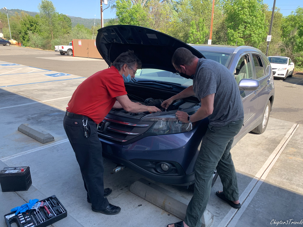 Kevin and Auto Zone employee replacing car battery