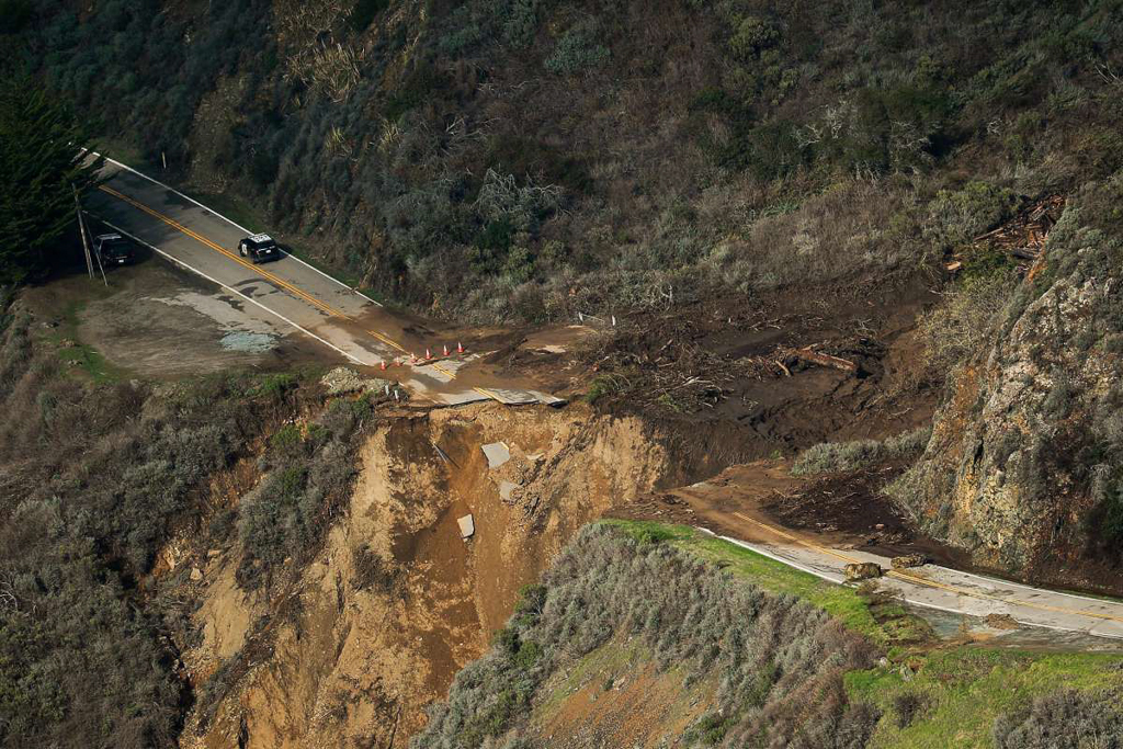 Aerial view of large section of roadway missing from Pacific Coast Highway