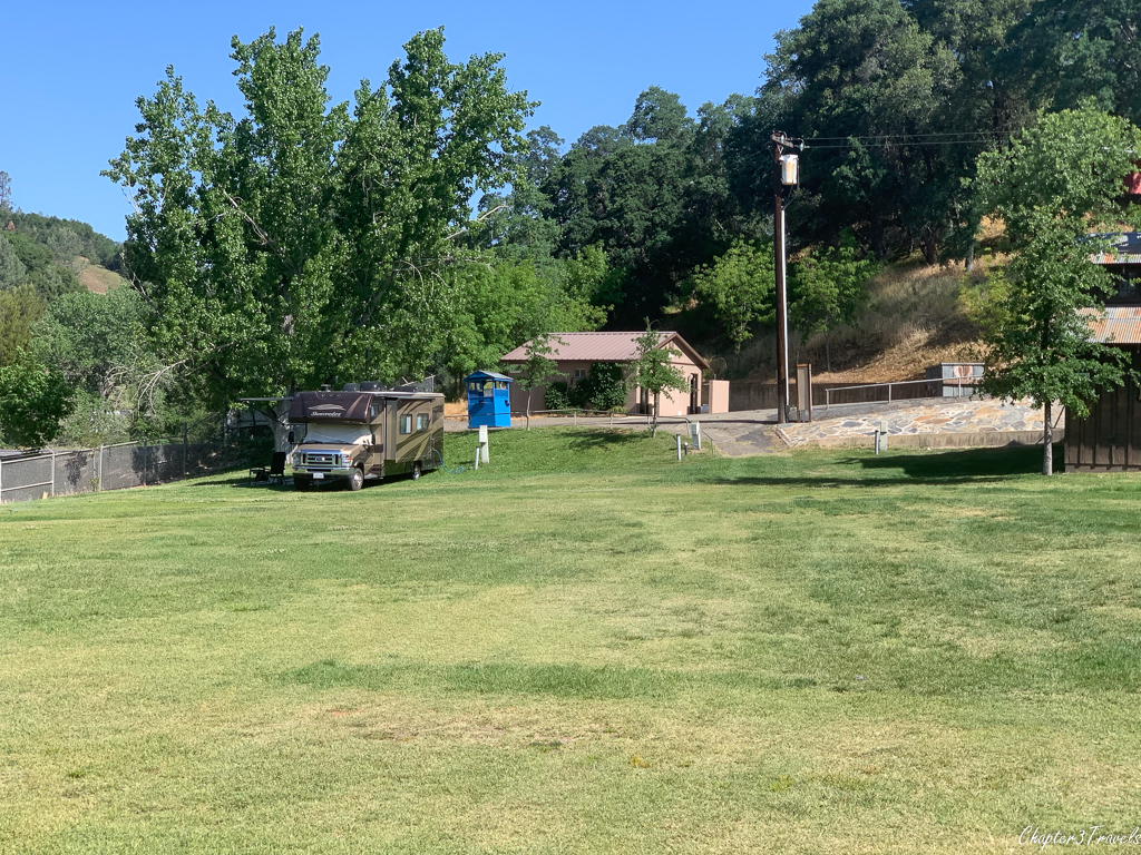 Large grassy area with campsites at Mariposa County Fairgrounds