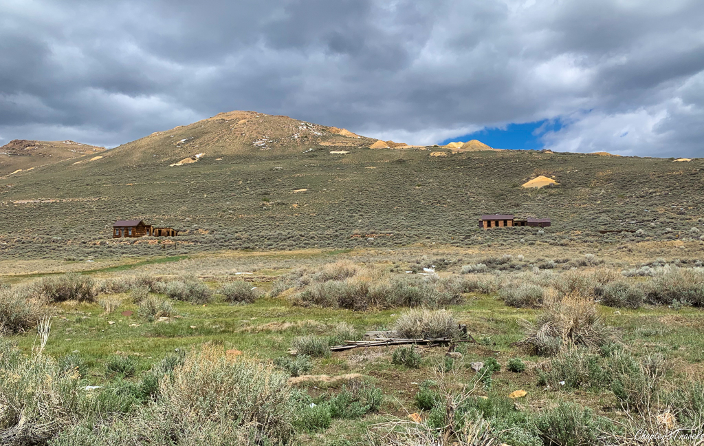 Two structures on a hill on the outskirts of Bodie
